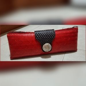 Adrienne Vittadini red and brown long straw clutch
